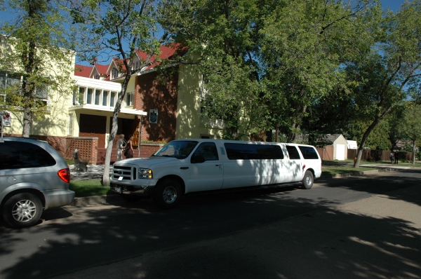The limousine pulls up at the church ....